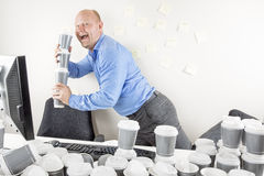 Happy businessman drinks too much coffee Stock Image
