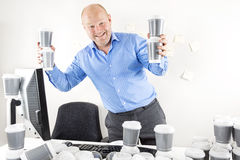 Happy businessman drinks too much coffee Royalty Free Stock Image