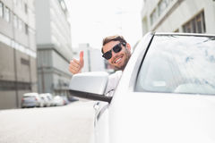 Happy businessman in the drivers seat Royalty Free Stock Photography