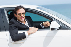 Happy businessman in the drivers seat Royalty Free Stock Images