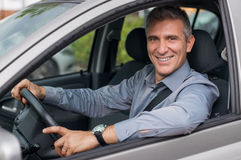 Happy Businessman Driving Car Stock Photography