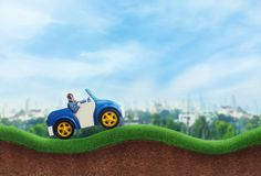 Happy businessman driving a toy car Royalty Free Stock Photography