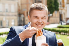 Happy businessman eating Chinese noodles Stock Images