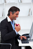 Happy businessman eating a red apple Royalty Free Stock Photo