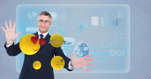 Happy businessman with emojis. Digital composite of Happy businessman with emojis Stock Photo