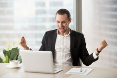 Happy businessman excited because of success. Happy businessman excited because of great deal, achievement, company success. Young entrepreneur screaming with Stock Images
