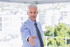 Happy businessman extending arm for handshake Royalty Free Stock Images