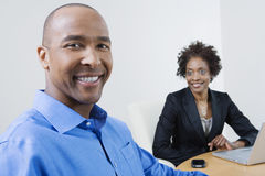 Happy Businessman With Female Colleague At Office Royalty Free Stock Image