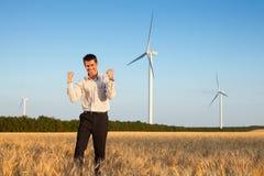 Happy businessman in a field Stock Photo