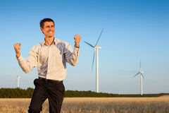 Happy businessman in a field Stock Image