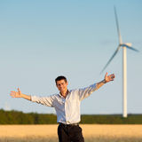 Happy businessman in a field Royalty Free Stock Photography