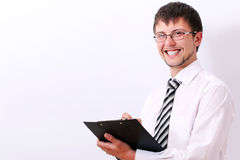 Happy businessman is filling documents Royalty Free Stock Photo