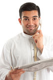 Happy businessman with financial newspaper Royalty Free Stock Image