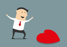 Happy businessman finding a love heart Stock Photos
