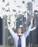 Happy businessman and flying dollar Royalty Free Stock Photos