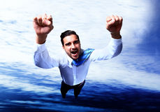 Happy businessman flying Stock Images