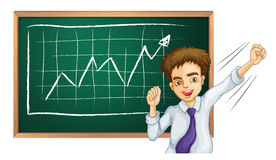 A happy businessman in front of the board Stock Image