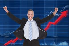 Happy businessman in front of graph royalty free stock photo