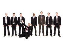 Happy businessman in front of his team Royalty Free Stock Photos
