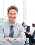 Happy businessman in front of his teamwork Royalty Free Stock Image