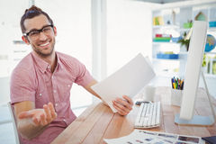 Happy businessman gesturing while holding documents Royalty Free Stock Image