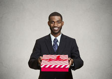 Happy businessman giving gift box to someone Royalty Free Stock Images