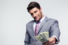 Happy businessman giving money on camera Royalty Free Stock Photography