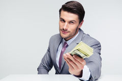 Happy businessman giving money on camera royalty free stock images