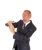 Happy businessman giving sign with hands. Stock Photography