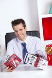 Happy businessman giving valentine day gifts Royalty Free Stock Images