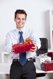 Happy businessman giving valentine day gifts Stock Image