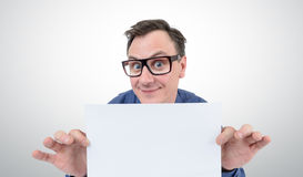 Happy businessman in glasses holding a white sheet of paper Royalty Free Stock Photo