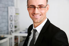 Happy businessman in glasses standing Stock Photography