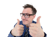 Happy businessman in glasses with thumbs up Stock Images