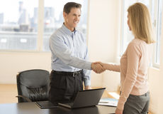 Happy Businessman Greeting Candidate In Office Stock Image