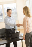 Happy Businessman Greeting Candidate In Office Stock Photo