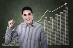 Happy businessman with growing graph Royalty Free Stock Image