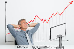 Happy businessman with growing share Stock Image