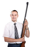 Happy Businessman with gun. Handsome happy Businessman smiling with gun at white background Royalty Free Stock Photo