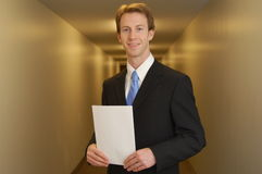 Happy Businessman in Hallway Royalty Free Stock Photo