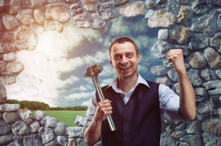 Happy businessman with hammer Royalty Free Stock Image