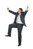 Happy businessman with hands and leg up Royalty Free Stock Image