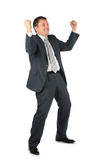 Happy businessman with hands up Stock Photo