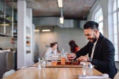 Happy businessman having food in restaurant stock photos