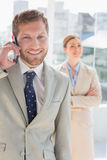 Happy businessman having phone conversation Royalty Free Stock Photo