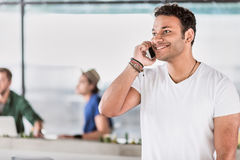Happy businessman having successful conversation by smartphone Stock Photography