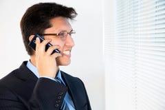 Happy businessman having telephone call Stock Image