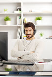Happy businessman with headphone Royalty Free Stock Photos