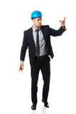 Happy businessman in helmet points his finger up. Stock Photography