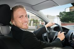 Happy businessman in his car Stock Image